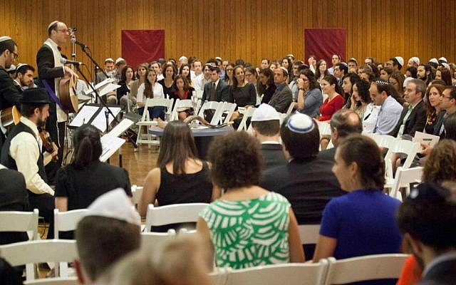 Riverway Project members gather at Boston's Temple Israel for High Holidays services led by Rabbi Matthew Soffer. (Courtesy Riverway Project/JTA)