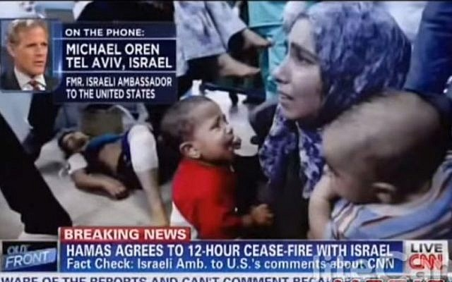Michael Oren, interviewed on CNN on a screen filled with images from Gaza (YouTube screenshot)