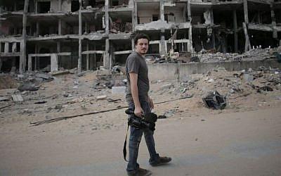 This Monday, August 11 2014 photo shows Associated Press video journalist Simone Camilli in Beit Lahiya, Gaza Strip.(photo credit: AP/Khalil Hamra)