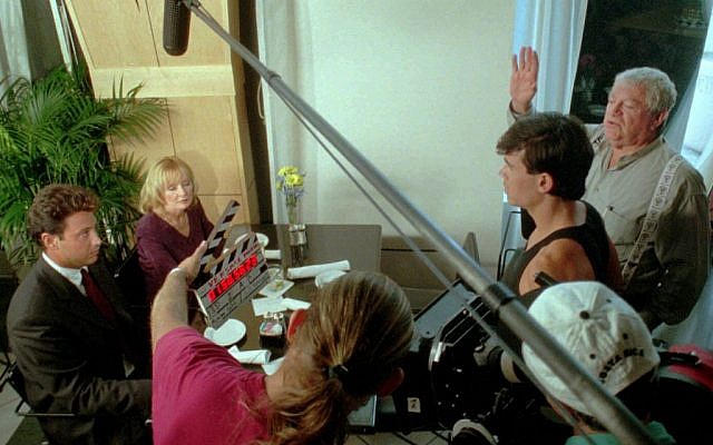 """In this Monday, Sept. 15, 1997 file photo, veteran movie maker Menahem Golan, right, motions for action during filming of """"The Versace Murder"""" on location in Ft. Lauderdale, Fla. Golan, a veteran Israeli filmmaker who produced some of the biggest action movies of the 1980s, has died in Tel Aviv. He was 85. (photo credit: AP Photo/Gregory Smith)"""