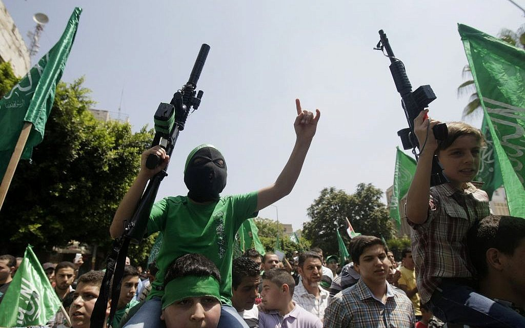 Palestinian boys with Hamas supporters hold toy guns and shout slogans during a demonstration in the West Bank city of Nablus on Friday, Aug. 15, 2014. (photo credit: AP Photo/Nasser Ishtayeh)