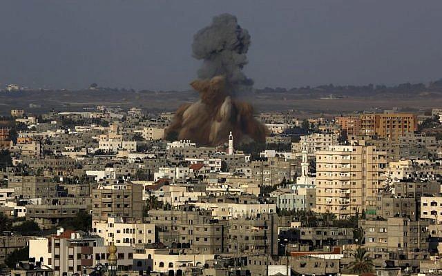 Smoke and debris rise after an Israeli strike hit Gaza City in the northern Gaza Strip, Tuesday, Aug. 19, 2014. (photo credit: AP Photo/Adel Hana)