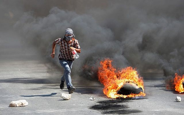 Illustrative photo of a Palestinian protester during clashes with Israeli soldiers in the West Bank city of Nablus, August 22, 2014. (photo credit: AP/Nasser Ishtayeh)