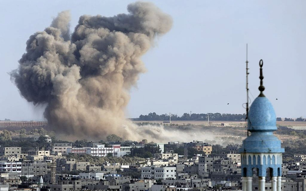 Smoke from an Israeli strike rises over Gaza City, Gaza Strip, Saturday, August 9, 2014.(photo credit: AP/Lefteris Pitarakis)