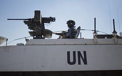 Armored vehicles of UN peacekeepers of UNDOF, the United Nations Disengagement Observer Force, wait to cross from the Israeli-controlled Golan Heights to Syria, on Thursday, August 28, 2014. (photo credit: AP/Ariel Schalit)