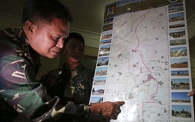 Philippine military chief Gen. Gregorio Pio Catapang shows reporters where Filipino peacekeepers in Golan Heights have been repositioned during a press conference at Camp Aguinaldo military headquarters in suburban Quezon city, Philippines on Sunday Aug. 31, 2014. (photo credit: AP Photo/Aaron Favila)