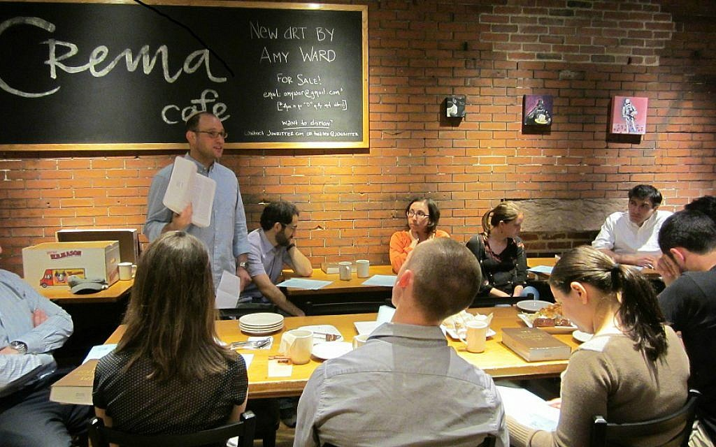 Rabbi Matthew Soffer, director of the Riverway Project, leads a Torah discussion at a Riverway Cafe gathering in Cambridge, Mass., May 2014. (Courtesy Riverway Project/JTA)