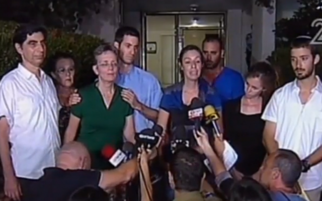 The family of missing soldier Hadar Goldin speaks to the press, August 2 (screen capture: Channel 2)