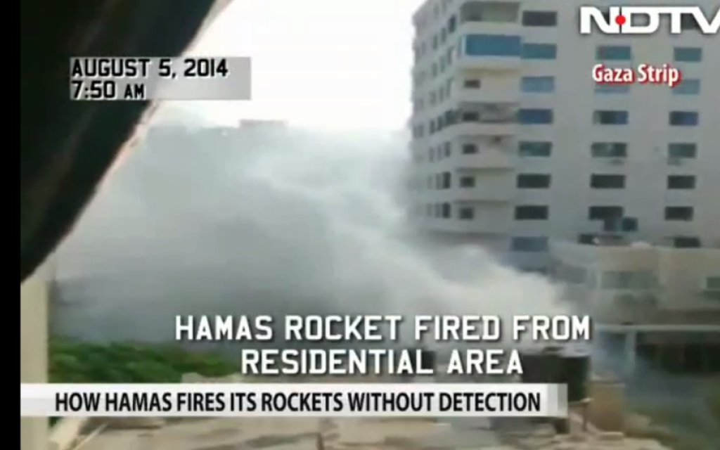 Indian TV crew films Hamas rocket launch from Gaza City residential area, August 5, 2014 (NDTV screenshot)