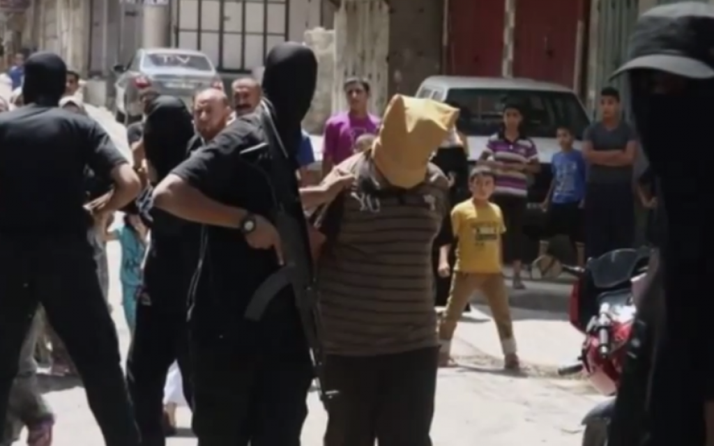Illustrative: A Hamas gunman holding an alleged 'collaborator' in Gaza, moments before the suspect is shot to death, on August 22, 2014. (screenshot: YouTube)