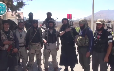 Al-Nusra Front fighters standing near the Quneitra crossing between Israel and Syria. (screen capture: YouTube)