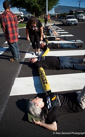Many of Jewish Voice for Peace protests are BDS-driven. Here, a 'die-in' against Boeing in Seattle, July 28. 2014. (Alex Garland Photography)