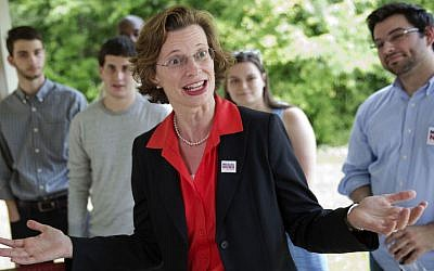 This May 13, 2014, file photo shows Georgia Democratic Senate hopeful Michelle Nunn as she greets campaign volunteers at South DeKalb Community Achievement Center in Decatur, Ga. (AP Photo/David Goldman, File)