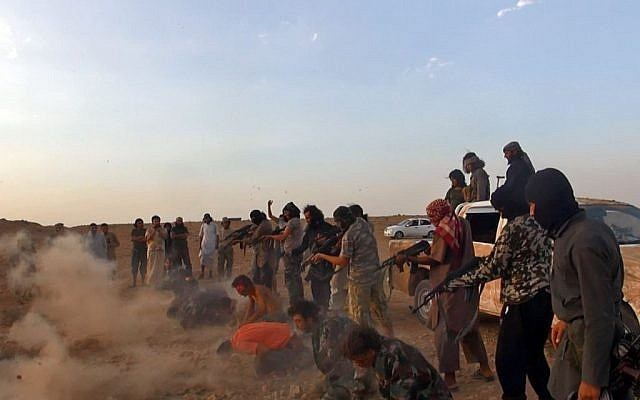 Masked gunmen of the Islamic State shooting seven men kneeling in front of them, in the aftermath of the group's takeover of the Tabqa air base in Raqqa province, Syria. (photo credit: AP/Raqqa Media Center of the Islamic State group)