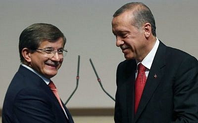 Turkey's president-elect Recep Tayyip Erdogan, right, greets Foreign Minister Ahmet Davutoglu after he announced Davutoglu as his ruling Justice and Development Party's new leader, in Ankara, Turkey, on Thursday, August 21, 2014. (AP Photo/Burhan Ozbilici)