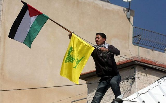 A Hezbollah flag is hung outside the home of the Palestinian terrorist responsible for killing eight students at Yeshivat Mercaz Harav in Jerusalem on March 6, 2008 photo credit: Flash90)