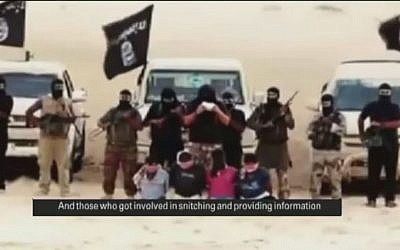 Members of Ansar Bayt al-Maqdis in the Egyptian Sinai read out sentences before they behead four men accused of spying for Israel, August 2014 (screen capture: YouTube)