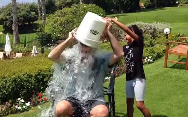 US ambassador Dan Shapiro getting icy water poured on his head. (photo credit: YouTube screen capture)