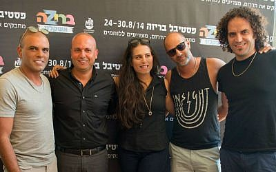 Ashkelon mayor Itamar Shimoni (second from left) and performers who will be onstage at the city's Briza Festival during the last week of August (photo credit: Sigal Eiland)