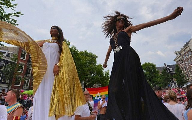 Israeli pop singer Dana International, right, dancing on the Jewish boat at the Amsterdam gay pride parade, Aug. 2, 2014. (Cnaan Liphshiz/JTA)