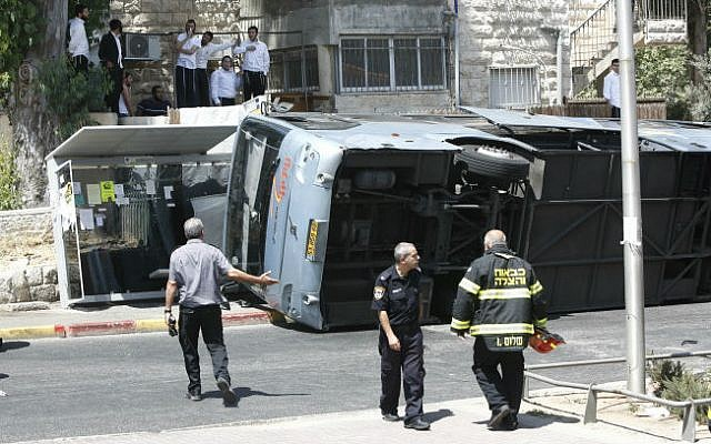 The scene where a tractor driver flipped over a bus on Shmuel Hanavi Street in Jerusalem, on Monday, August 4, 2014. (photo credit: Yonatan Sindel/Flash90)