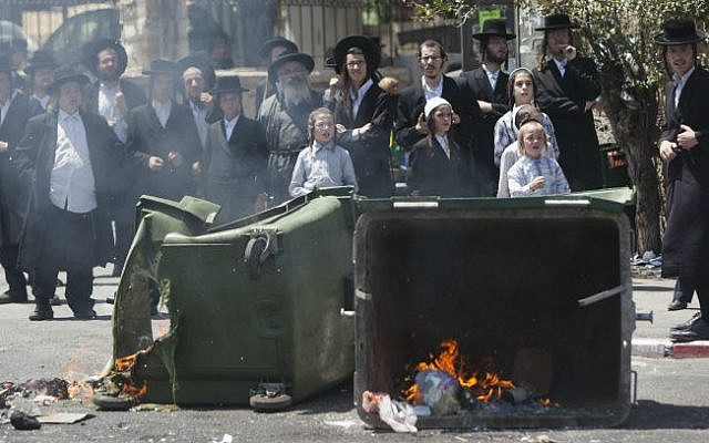 Ultra-Orthodox Jews seen during a protest against desecrated graves on Route 1 in Jerusalem on August 14, 2014 (photo credit: Yonatan Sindel/Flash90)
