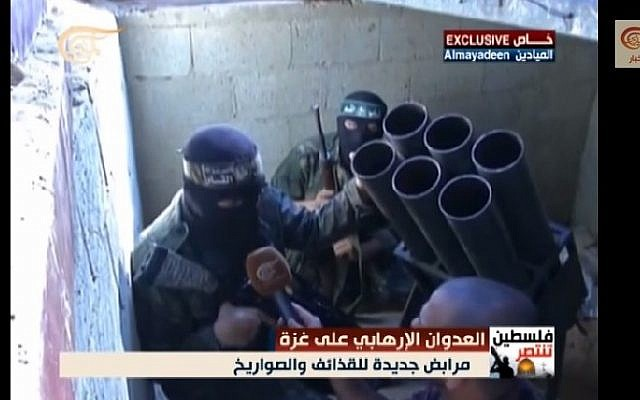 In footage captured by al-Mayadeen, Hamas Izz ad-Din al-Qassam Brigades fighters are seen preparing rockets to launch against Israel in a tunnel underneath the Gaza Strip, August 2014. (screen capture, YouTube)