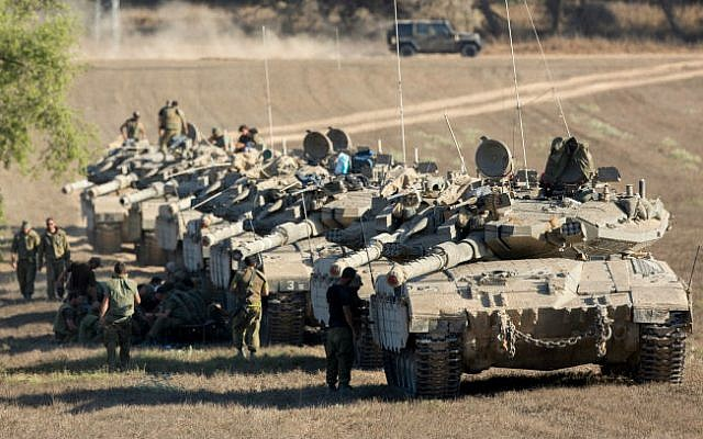 A convoy of IDF tanks park at a deployment area near the border with the Gaza Strip on August 2, 2014 (photo credit: Yonatan Sindel/Flash90)