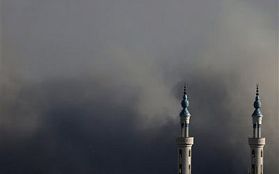 Smoke rises over Gaza City after an Israeli strike on Friday, Aug. 8, 2014 (photo credit: AP/Hatem Moussa)