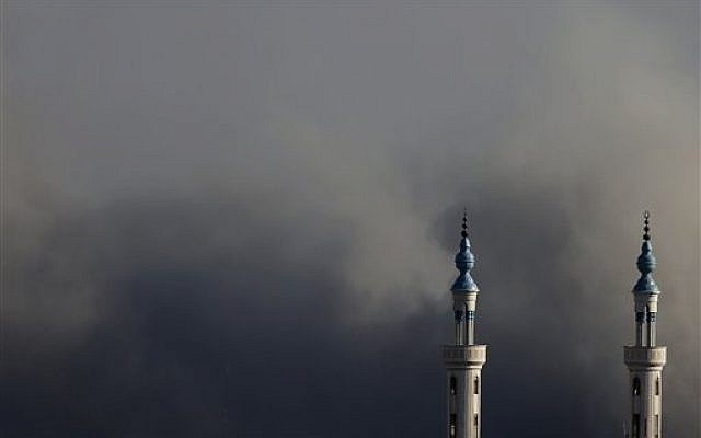 Smoke rises over Gaza City after an Israeli strike on Friday, Aug. 8, 2014 (photo credit: AP/Hatem Moussa)