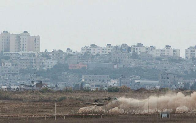 An Israeli tank holding a position inside the southern Gaza Strip on August 2, 2014 (photo credit: Yonatan Sindel/Flash90)