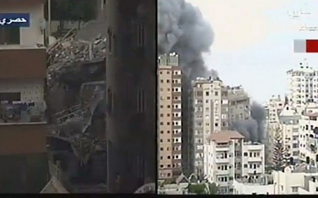 Screenshot from a video showing the collapse of a Gaza apartment building after it was targeted in an Israeli aistrike, August 23, 2014.