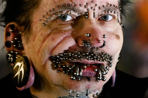 German Rolf Buchholz shows his face with 168 piercings as he visits the 20th Tattoo Convention in Berlin, December 4, 2010 (photo credit: AP/Markus Schreiber, File)
