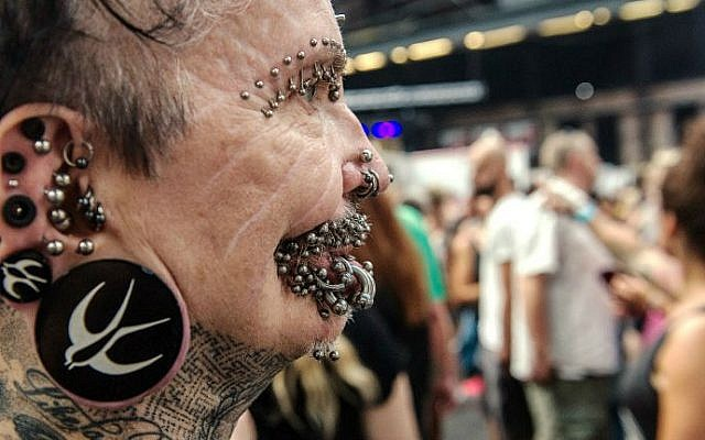 Rolf Buchholz, the world's most pierced man, attends a tattoo convention in Berlin on August 2, 2014 (photo credit: Paul Zinken/ DPA/AFP)