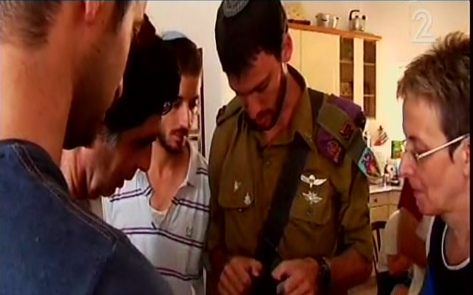 Lt. Eitan, in uniform, meeting with the Goldin family on Tuesday. (Screen capture: Channel 2)