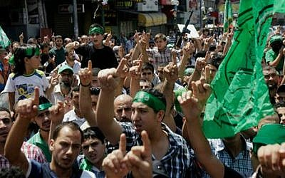 Hamas supporters at a demonstration in the West Bank city of Nablus on Friday, Aug. 15, 2014 (photo credit: AP Photo/Nasser Ishtayeh)