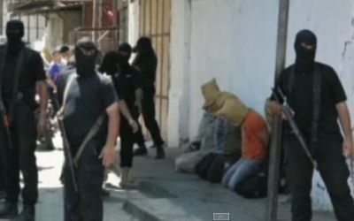 Hamas gunmen in Gaza with suspected collaborators in August 2014. (screen capture: YouTube/euronews)