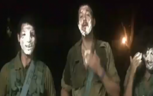 IDF soldiers issue hummus tub challenge (screen capture: Facebook)