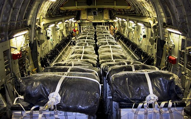 Straps secure water bundles aboard a C-17 Globemaster III before a humanitarian airdrop over Iraq on August 8, 2014. (photo credit: US Air Force)