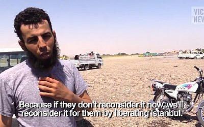 VICE reporter Medyan Dairieh interviews an Islamic State member in Raqqa. (screen capture: YouTube)