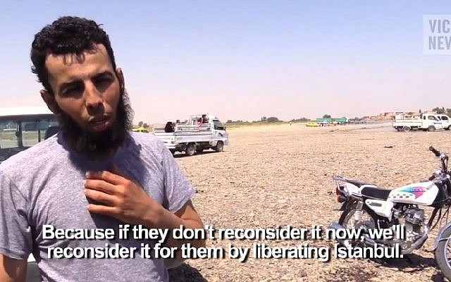 VICE reporter Medyan Dairieh interviews an Islamic State member in Raqqa. (screen capture: YouTube)