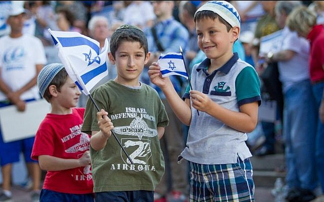 Some of Israel's younger supporters show their pride in the Jewish state at August 7's Rally for Israel in Boston (photo credit: Elan Kawesch/The Times of Israel)