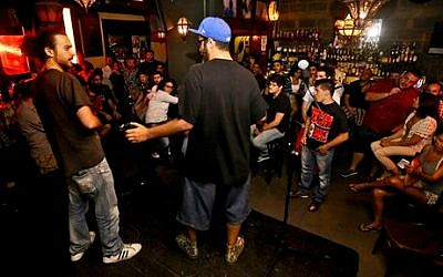Lebanese rappers perform during an open-mic show at Radio Beirut, in Lebanon, July 7, 2014. (photo credit: AP/Bilal Hussein)
