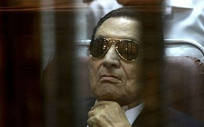 Ousted Egyptian President Hosni Mubarak attends a hearing in his retrial over charges of failing to stop killings of protesters during the 2011 uprising that led to his downfall, in the Police Academy-turned-court in the outskirts of Cairo, Egypt,  April 26, 2014 . (photo credit: AP/Tarek el Gabbas)