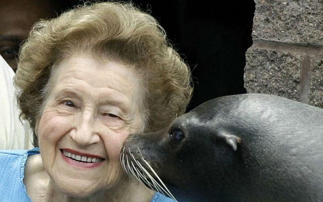 Former Pittsburgh Mayor Sophie Masloff is kissed by Maggie, a sea lion at the Ptitsburgh Zoo & Aquarium, in Pittsburgh. Masloff, who rose from a tax clerk to become Pittsburgh's first female mayor, died Sunday, Aug. 17, 2014. She was 96. (AP Photo/Gene J. Puskar, File)