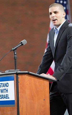 IDF reserve officer and Brandeis University student Ohad Elhelo addresses an August 7 rally in Boston about serving in Gaza last month (photo credit: Elan Kawesch/The Times of Israel)