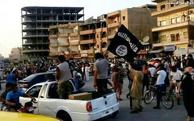 This undated file photo posted by the Raqqa Media Center, a Syrian opposition group, on Monday, June 30, 2014, which has been verified and is consistent with other AP reporting, shows fighters from extremist Islamic State group during a parade in Raqqa, Syria (AP/Raqqa Media Center, File)