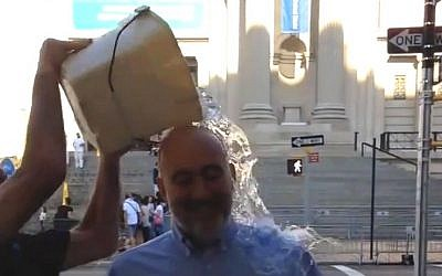Ron Prosor, Israel's ambassador to the UN, is dowsed with ice water as part of the ALS Ice Bucket Challenge, in a video released Tuesday, August 19, 2014 (screen capture: YouTube)