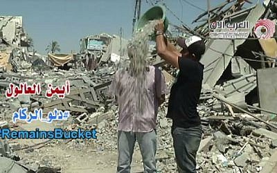 Palestinian journalist Ayman Aloul invents the 'Rubble Bucket Challenge.' (photo credit: screen capture YouTube/Ayman Aloul)
