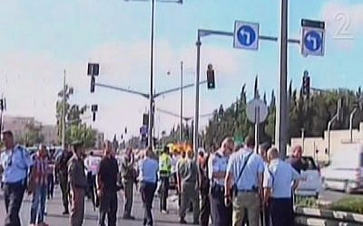 Police at the scene of a shooting near Wadi al-Joz and Mount Scopus in Jerusalem, on Monday, August 4, 2014. (photo credit: Screen capture Channel 2)